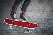 Skateboarder jumping on sketched board — Stock Photo
