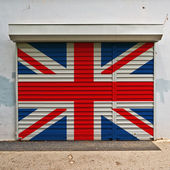 Great Britain flag on shop door — Stock Photo