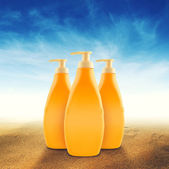 Bottles of Sunbath oil or sunscreen — Stock Photo