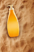 Bottle of Sunbath oil or sunscreen — Stock Photo