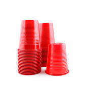Plastic red cups stack on white background — 图库照片