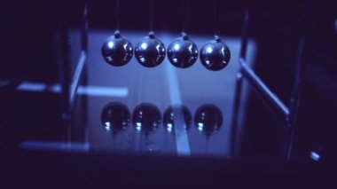 Pendulum or Newton cradle swinging. Close up detail with selective focus HD footage, 1920x1080. — Stock Video