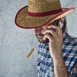 Farmer with cowboy straw hat — Stock Photo #49023625