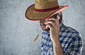 Farmer with cowboy straw hat — Stock Photo