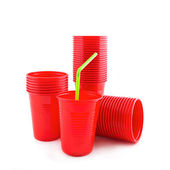 Plastic red cups on white background — Stock Photo