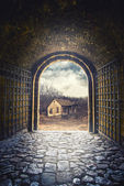 Gate opening to road leading to an old abandoned house — Stock Photo