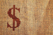 Light natural burlap texture with dollar symbol — Stockfoto