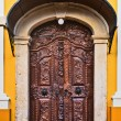 Old carved wooden church door — Stock Photo