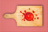 Tomato and ketchup on wooden board — Stock Photo