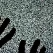 Male hands crawling up the TV screen with static television noise as background. 1920x1080 full hd footage. — Stock Video #49949091