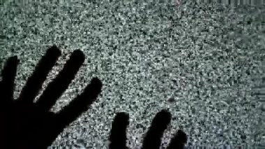 Male hands crawling up the TV screen with static television noise as background. 1920x1080 full hd footage. — Stock Video