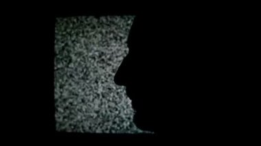 Unshaven man profile silhouette in front of static TV noise background. 1920x1080 full hd footage. — Stock Video