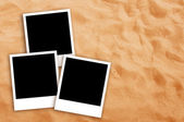 Three Blank photo frames on beach sand — Zdjęcie stockowe