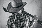 Western country cowboy musician with guitar — Stock Photo