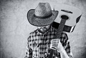 Western country cowboy musician with guitar — Stok fotoğraf