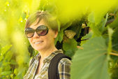 Smiling young adult woman in vineyard — Stock Photo