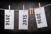 Three Envelopes with year numbers on clothes rope — Stock Photo
