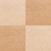 New beige checkered carpet texture — Stock Photo