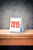 2015 calendar on wooden table — Stock Photo