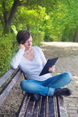 Woman reading E-book on digital tablet computer — Stock Photo