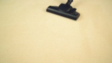 Vacuum Cleaner sweeping Brand New Carpet. Housework and home hygiene — Vídeo de stock