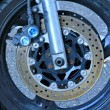 Wheel and motorbike — Stock Photo