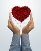 Valentine's day symbol on businessman hend — Stock Photo