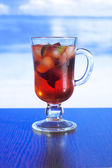 Cold tea with mint and fruit — Stock Photo