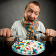 Man eating pills — Stock Photo