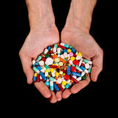 Hands full of pills — Stock Photo