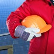 Stock Photo: Worker holding hardhat