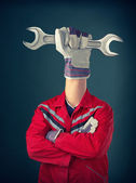 Worker with third hand — Stock Photo