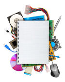 Computer hardware with blank notebook — Stock Photo