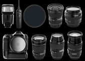Set of digital camera and lenses — Stock Photo