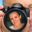 Photographer capturing portrait of beautiful woman — Stock Photo