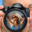 Photographer capturing portrait of bikini girl — Stock Photo #16802435