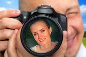 Photographer capturing portrait of beautiful woman — Stock Photo