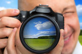 Photographer capturing rural landscape — Stock Photo