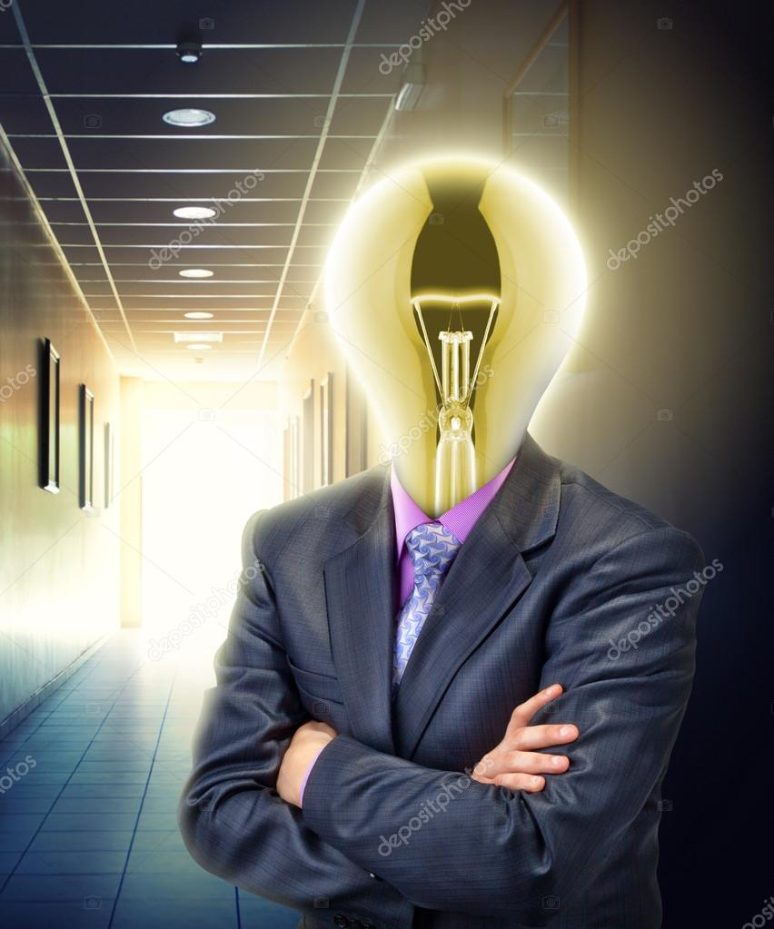Portrait of businessman with glowing bulb instead of the head — Stock Photo #16802443