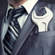 Businessman with spanner — Stock Photo #17621121