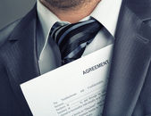 Businessman with agreement — Stock Photo