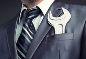 Businessman with spanner — Stock Photo