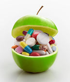 Apple full of medicines — Stock Photo