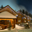 Ski chalets at night - Stock Photo