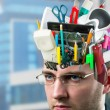 Businessman with accessories in head — Stock Photo #22064391