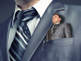 Small businessman in suit pocket — Stock Photo
