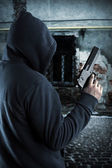 Gangster with gun at night — Stock Photo