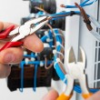 Hand of an electrician — Stock Photo