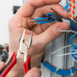 Hands of an electrician — Stock Photo #22834590