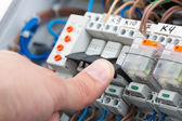 Turning on a fusebox — Stock Photo
